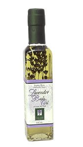 Lavender Bath Oil    A silken luxury to your skin and anyone who touches you. A recycled glass bottle holds organic sprigs of lavender in a lanolin-infused safflower oil that actually disperses in water. Essential oils of lavender and sweet orange release their relaxing fragrance in the warmth of the tub, or on the body after a shower.    8.5 fl. oz.    $19.90 with free shipping