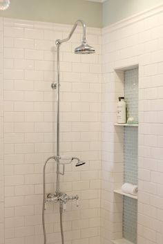 shower fixture..I like the colour of the blue subway tile in the shelf area