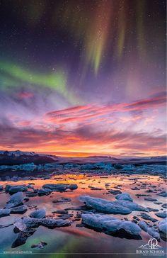 Aurora over Jokusarlon • pastel northern lights light up the glacier bay, Iceland