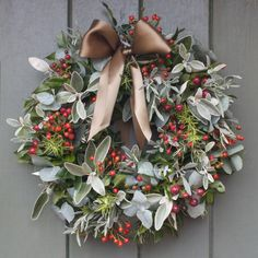 Fancy making a wreath?  Search 'make a Christmas wreath' by Alexandra Gibbs in the Amazon kindle store.  Follow the instructions/photographs adapting to the foliage used here.   This wreath combines Rose Hips and Hypericum Berries with Rosemary, Lavender and Eucalyptus finished with a beautiful green ribbon to tie to your door.