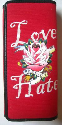 Its all about Red! Ej's Red Tattoo purse $19.95 Free Shipping!     Accessorizing is very important for Your Brand Space! Island Heat Products www.islandheat.com today's clothing Fashions and Home Goods with Great Family Gift Idea's.