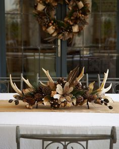 This natural centerpiece is the perfect way to dress up your table for the holidays!