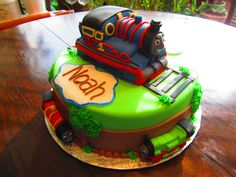 """Thomas and Friends Cake - Chocolate cake with chocolate butter cream filling - fondant covered, fondant covered  """"Thomas"""" and fondant """"Percy"""" and """"James"""""""