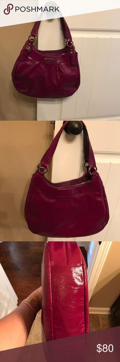 Purple Coach Handbag Beautiful purple patent leather Coach handbag. Used. In good condition. Does have a light pinkish purple stain in center compartment. Coach Bags Shoulder Bags