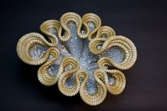 Hand built porcelain wave. Hi fired with celadon and crawl.  Woven with horse hair and waxed thread.