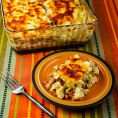 Layered Mexican Casserole Recipe with Chicken, Green Chiles, Pinto Beans, and Cheese; this is delicious and family friendly and suitable for the SBD Phase One. [from KalynsKitchen.com]