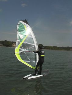 A Poole Windsurfing student taking a 1 to 1 private windsurf lesson to really accelerate their learning.  Great conditions windsurfing in Poole Harbour! #poolewindsurfing #windsurfinglessons #pooleharbour