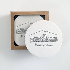 Boxed set of 10 letterpress coasters featuring our Marietta, Georgia skyline  - Original artwork by Natalie Kilgore - Each coaster measures 4 in diameter - Coasters come packaged in a 4 1/8 x 7/8 x 4 1/8 kraft box with clear poly window - Made from environmentally friendly recycled paper pulp; letterpressed with rubber-based ink - Pressed and assembled locally in Athens, Georgia at Smokey Road Press  *Currently offered in black. Please contact me for inquiries about bulk orders...