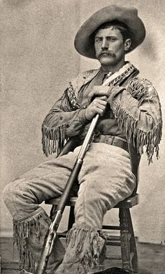 Jack Clark holds an 1873 Winchester Rifle /Shown at Fort Walsh, the North West Mounted Police outpost, in 1881, Jack Clark holds an 1873 Winchester and wears prairie attire that is in keeping with the Rocky Mountain Ranger uniform. The force often took on former policemen as civilian scouts, since many of them were intermarried with natives or Métis and thus offered valuable experience, especially during the years of Sitting Bull's Sioux exile in the Cypress Hills. – Courtesy Provincial ...