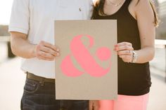 This simple stamped ampersand makes for a fab engagement photo shoot prop. #MarthaStewartWeddingsMagazine