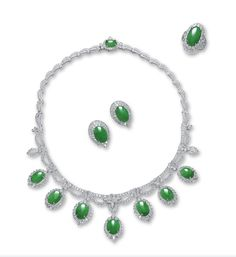 Jadeite and diamond demi-parure. Necklace suspending a fringe of oval jadeite cabs of translucent green color, framed by diamonds, supported by a festoon of millegrain-set diamonds, with a clasp set with a jadeite cab; matching earrings set with an oval Sparkly Jewelry, Jade Jewelry, Jewelry Sets, 1920s Jewelry, Schmuck Design, Pear Shaped, Luxury Jewelry, Jewelry Stores, Earring Set