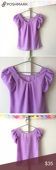 Pretty Purple Puffy Princess Blouse A beautiful purple blouse fit for a princess! Has puffy short sleeves and a lined front. The rest of the blouse is sheer. Shoulders: 13 inches/chest: 34 inches/length: 22.5 inches Tops Blouses