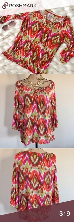 """Jones NY print top Cute Aztec print top in pretty shades of fuchsia, orange, green, and brown from Jones New York. 3/4 sleeves, elasticized cuffs and hemline, drawstring neckline. Size L. Excellent condition. 100% viscose. Machine wash. Incredibly soft! Bust measures 21 1/2"""", length 25"""".  🛍 Jones New York Tops"""