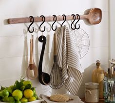 Kitchen Décor/Organisation - In this feature, the wooden spoon and steel hooks give a homely rustic feel to the kitchen and match well with the other natural toned items