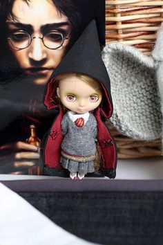 I love this little doll in her Harry Potter costume. How I would love to have one.