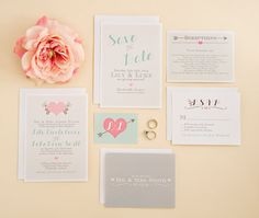 Grey, pinks and peach in this wedding invitation suite.
