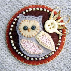 A darker example of a cute owl pin.  I can't wait ot make this!
