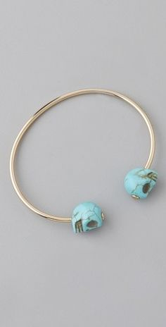 Turquoise golds and SKULLS.