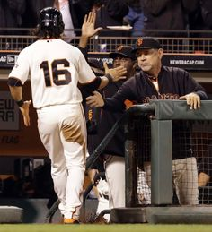 San Francisco Giants manager Bruce Bochy, right, congratulates Angel Pagan (16) after Pagan scored against the Colorado Rockies in the seventh inning of a baseball game Wednesday, Aug. 27, 2014, in San Francisco. Pagan scored on a single by Buster Posey. (AP Photo/Ben Margot)