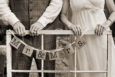 Bride and Groom Mr. and Mrs. photo with old window frame as prop