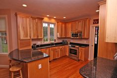 cabinets around refrigerator | The large refrigerator/full freezer can be seen along the side of the ...