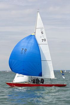 The Swallow class sailboat 'Curlew' with spinnaker racing in the Solent during Cowes Week 2013.