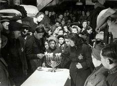 Westerbork, Holland, Lighting of Hanukkah candles in the camp. - Westerbork, Holland, 1942-1943, a personal album of camp commander Albert Konrad Gemmeker.