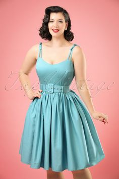 This 50s Jade Swing Dress is a classic 1950s style summer dress!  You'll feel like a real vintage princes when wearing this fifties classic! The bodice features a lovely sweetheart neckline and adjustable double shoulder straps with bow detail at the shoulder, CUTE! The wide matching belt accentuates your waist just perfect for a beautiful defined silhouette. Made from a light blue cotton blend with a light stretch that will move gracefully with every step you take. Add pea...