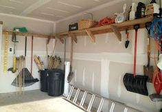 Shelving that has storage space above and hanging hooks below works great for organizing a packed garage.