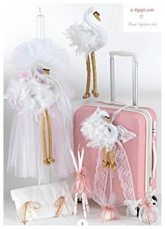 Complete baptism Greek orthodox set Swan baby girl christening set Themes options available code: 1901005KW12SET SET CONTAIN 1)Travel suitxase -SIZE aprox 13.80x8.55x22.15---35x22x57 cm 2)Decorated candle 35.4---90 cm 3)Decorated oil bottle 4)3 candles 5)Soap for the priest 6)Ladopana set