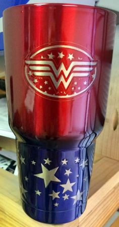 http://www.idecz.com/category/Yeti/ Wonder Women Yeti, powder coated and laser etched.