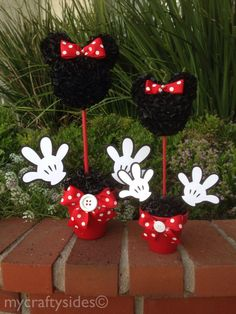 This listing is for one (1) Minnie Centerpiece. It stands 15 tall and 9 wide with hands inserted, and is in a 4 red, hot pink or light pink painted clay pot. The head is about 5 in diameter and is made of more than 300 black silk flowers flowers, topped with a red/hot pink and white polka dot bow.. The pot has Styrofoam and then topped with shredded black paper, and matching bow and button. This centerpiece is perfect for any table or candy bar. You will need to insert the hands as they will…