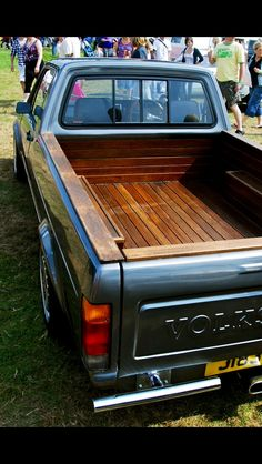 The wood work and paint on this Caddy is definitely something special. Mini Trucks, Gmc Trucks, Pickup Trucks, Vw Rabbit Pickup, Jeep Pickup, Volkswagen Touran, Vw Mk1, Vw Caddy Mk1, Truck Accesories