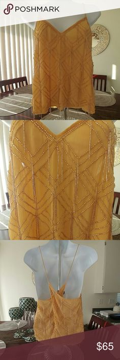 Sexy Beaded Top Gorgeous beaded top with crisscross back keyhole great for a summer night party! Free People Tops