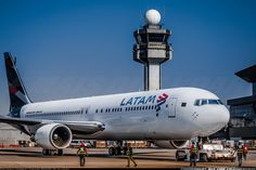 LATAM Brazil Boeing 767-316/ER preparing to depart on the first flight for LATAM Group, formed when LAN Chile and subsidiaries and TAM Brazil came together to form one pan-South American airline brand