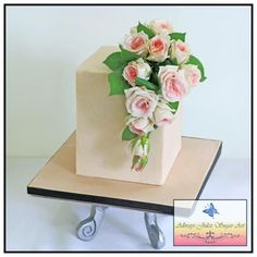 Chocolate layer cake with chocolate buttercream filling. Decorated with ivory buttercream and a spray of miniature roses. Buttercream Filling, Buttercream Flowers, Chocolate Buttercream, Mothers Day Chocolates, Mothers Day Cake, Square Cakes, Floral Cake, Elegant Cakes, Fancy Cakes