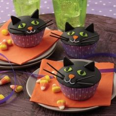 Wilton Black Cat Cupcakes from @officialacmoore.  These easy-to-decorate and delicious black cat cupcakes won't last long at your Halloween party!