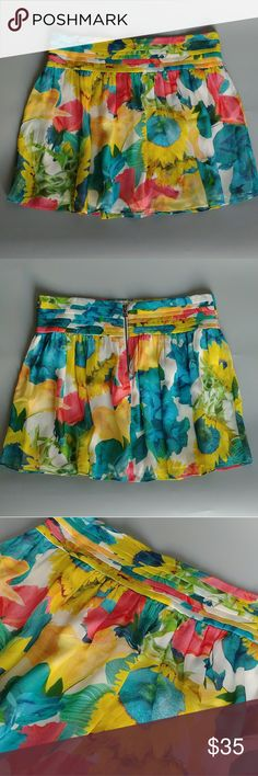 """Alice & Olivia floral silk skirt, 2 Beautiful lightweight silk skirt (fully lined) in a summery sunflower print. In excellent used condition with no stains, pulls or pills that I can see.  Laid flat waist 14"""", total length 14"""".  Smoke free home shared with a small dog. Reasonable offers welcome, bundle and save! Alice + Olivia Skirts Mini"""