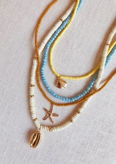 beaded jewelry DIY Beaded Shell Necklaces – Honestly WTF - A daily dose of fashion discoveries and inspirations, contributed by a stylist and a designer who both see the world through rose-colored shades. Shell Necklaces, Jewelry Necklaces, Beaded Bracelets, Necklace Ideas, Shell Bracelet, Long Necklaces, Beaded Anklets, Beaded Bracelet Patterns, Stackable Bracelets