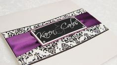 Purple ribbon on damask band with couple name on top
