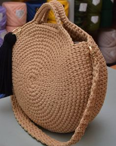 Crochet Patterns Bag Modest, but unrealistically steep She Crochet T Shirts, Crochet Diy, Crochet Tote, Crochet Handbags, Crochet Purses, Yarn Bag, Macrame Bag, Round Bag, Girls Bags