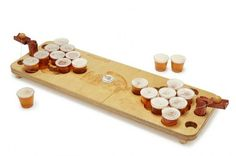Traditionally, drinking games mean the winner gets bragging rights and the loser gets a hangover. This Mini Beer Pong set is complete with smaller cups, so guys game night means sampling a selection of brewskies without overdoing it. But the winner still gets bragging rights. | $75 | UncommonGoods
