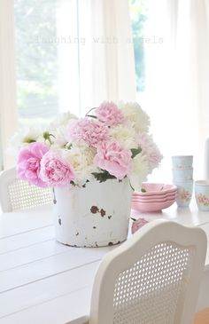 Pink peonies in shabby white pail in shabby chic cottage - gorgeous.  laughing with angels blog