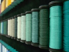 Teal shades of Kreinik Silk Serica, similar to a pearl cotton size, but 100% pure filament silk for the highest sheen.