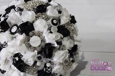 Sneak peek of a mixed media alternative bouquet. Features artificial flowers (roses) brooches, beads, buttons and crystals  www.nicsbuttonbuds.com.au www.facebook.com/nicsbuttonbuds  Black white damask