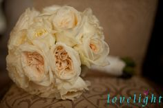 Ivory roses in this vintage chic bouquet