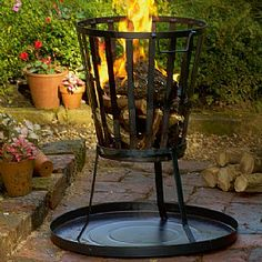 £66.50 Traditional Brazier  Inspired by the braziers or 'fire pits' commonly used from the Middle Ages, this smart powder-coated-steel brazier has a base plate to catch ash.