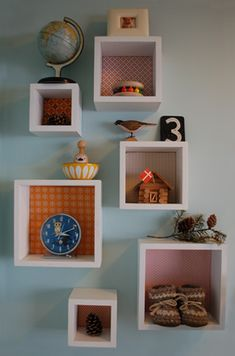 fabric-backed treasure wall. I have these same shelves in my kitchen for displaying kids' 3D artwork. But this made me realize how much some colored backing would improve them!