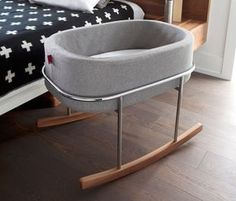 This modern handcrafted bassinet is a minimalist mother's dream. With its streamlined chrome stand and solid walnut rocking feet, the baby is nestled in a soft upholstered basket that can be removed and carried to different places.The basket can also be used for storage after your toddler has grown out of it to store all of their stuffed toys and trinkets.