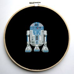 Star Wars Cross Stitch PDF pattern R2D2 On 14-count aida the design measures 4.6*5.9 inches. 64w X 82h Stitches. Sizes will change with count size. Design used 8 DMC thread colors. This pattern is in PDF format and consists of a floss list, and a color symbol chart. If you have